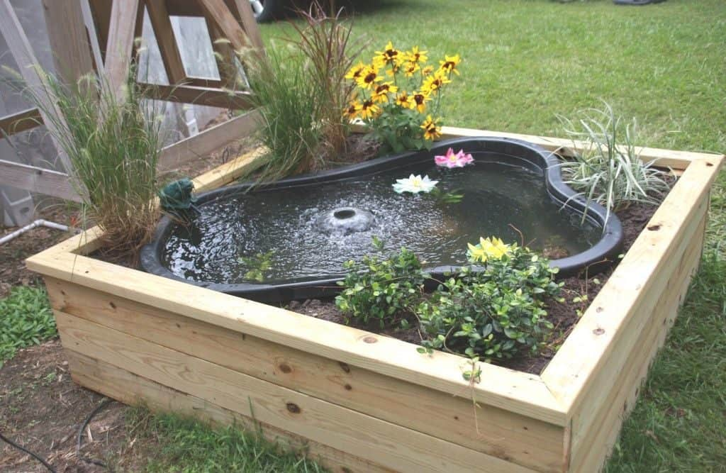21 Container Pond Ideas | Patio Pond Ideas For Small Spaces on above ground garden ponds ideas, diy small water feature ideas, raised garden pool ideas, raised pond kit, raised flower bed with pond, raised pond preformed, raised bed garden with pond, brick wall outdoor fountain ideas, raised turtle pond, raised koi pond, raised garden pond plans, raised garden for small ponds,